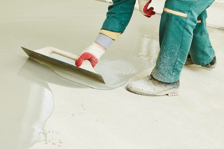 man installing epoxy flooring