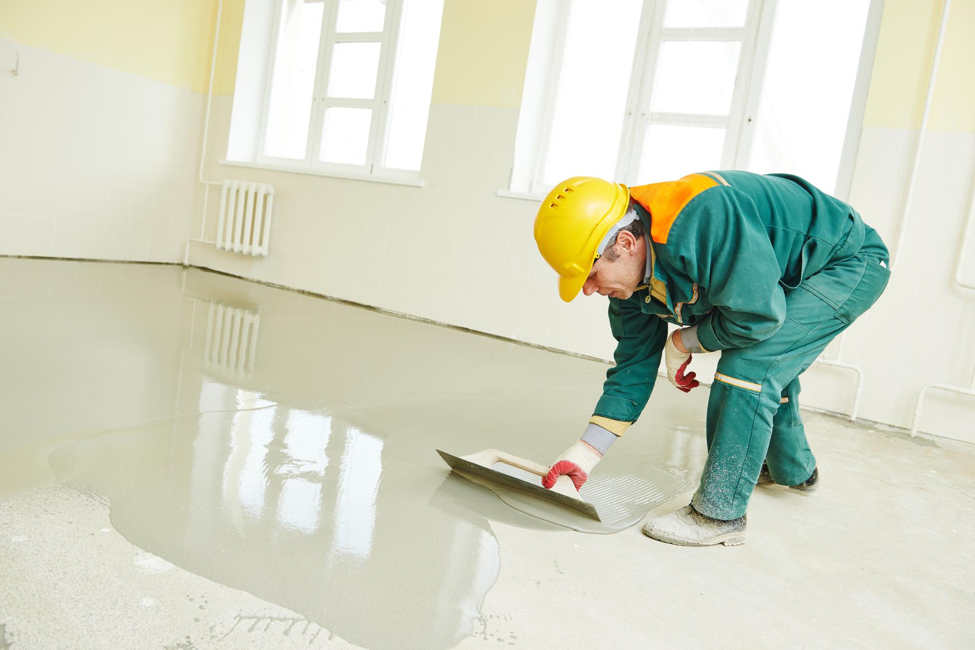 man installing epoxy flooring
